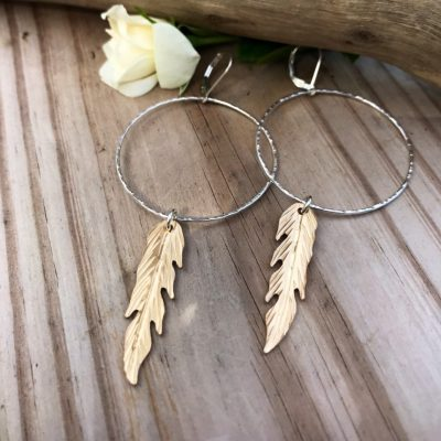 Large Sterling Silver Hammered Hoops are paired nicely with 14kt Gold Filled sawed and textured Feathers to make this stunning mixed metal pair of earrings. These are also available in all Sterling or all Gold Filled.