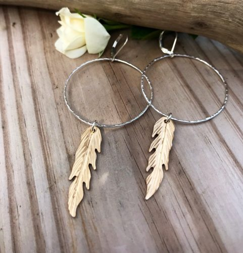 Large Sterling Silver HammeredHoops are paired nicely with 14kt Gold Filled sawed and textured Feathers to make this stunning mixed metal pair of earrings. These are also available in all Sterling or all Gold Filled.