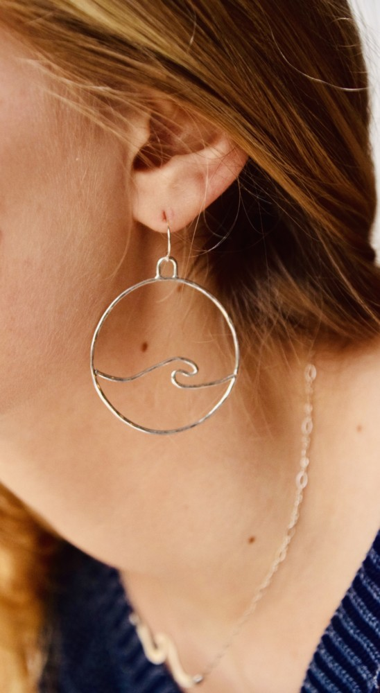 Catch the wave with our OG Medium Wave Earrings. These waves are made from sterling silver and unlike our hoop style, these hang from a French hook or leverback ear wire.