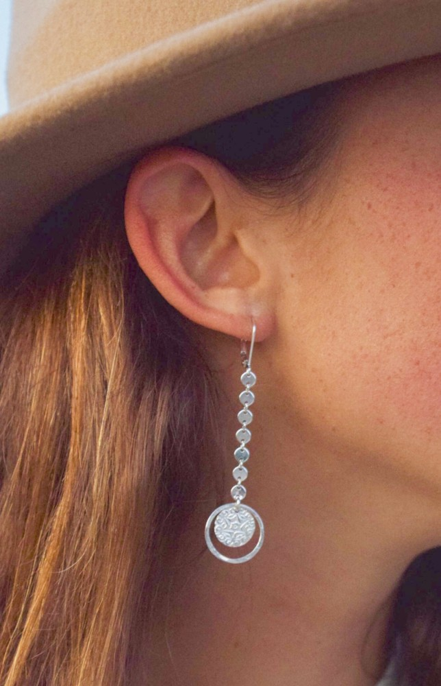 These Long Coin chain and starburst coin stand out on a sterling silver leverback earring.