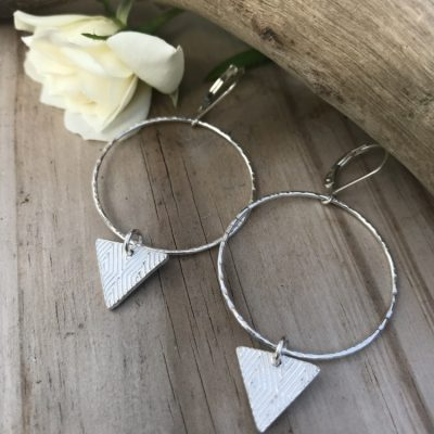 Tri~Dangle Sterling Silver Hoop Earrings are Hammered and finished on Sterling leverback earwires. A small triangle textured and made from fine silver will shift with your movements.