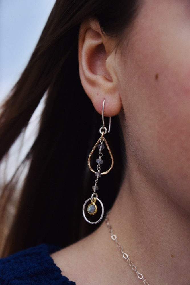 This beautiful earring design is a keeper. Lightweight and lots of movement, these will pick up the sun and hold its rays. Mixed Metal style of silver and gold with apatite beads and a small labradorite stone, dangling from our long v shaped earwire.