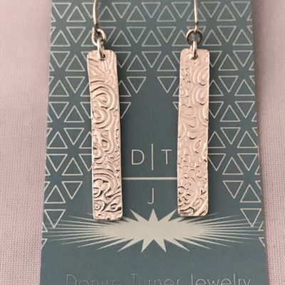 Recycled Fine Silver patterned bar earrings on long v shaped hooks.