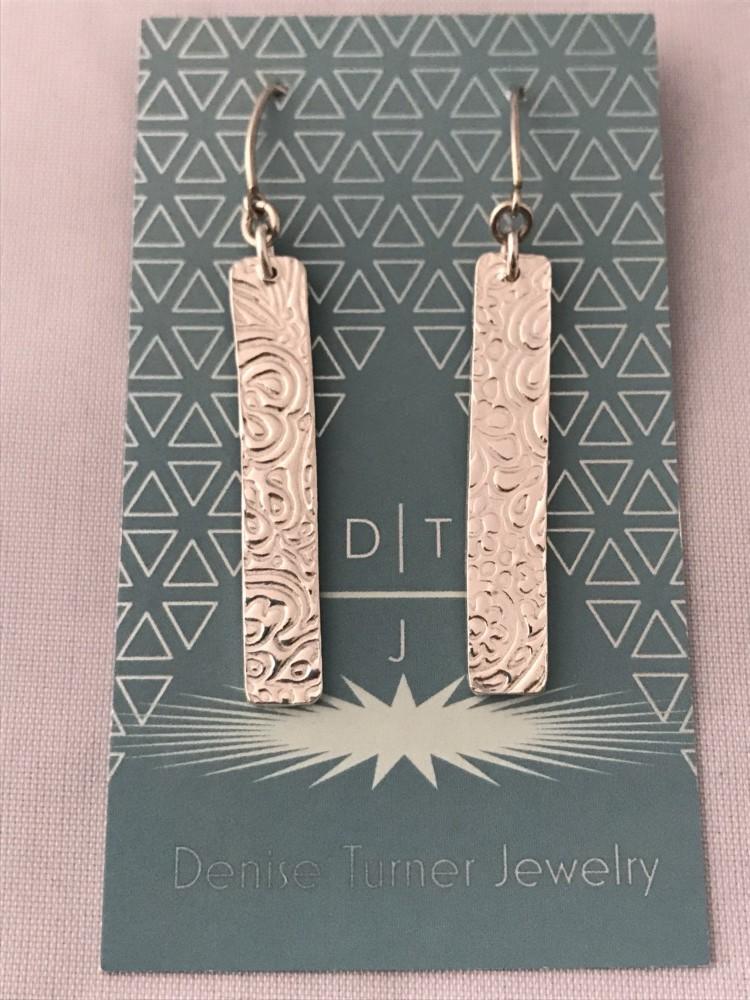 Recycled Fine Silver patterned bar earrings on long v shaped hooks.